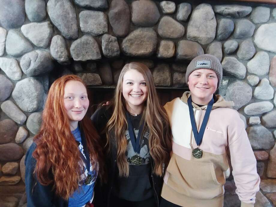 Pictured (from left to right) with their medals are Onekama's Alora Sundbeck, Michayla Bell and Kylar Thomas. Photo: Courtesy Photo
