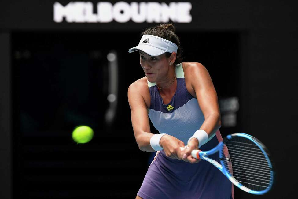 Spain's Garbine Muguruza hits a return against Australia's Ajla Tomljanovic during their women's singles match on day four of the Australian Open tennis tournament in Melbourne on January 23, 2020. (Photo by William WEST / AFP) / IMAGE RESTRICTED TO EDITORIAL USE - STRICTLY NO COMMERCIAL USE (Photo by WILLIAM WEST/AFP via Getty Images)