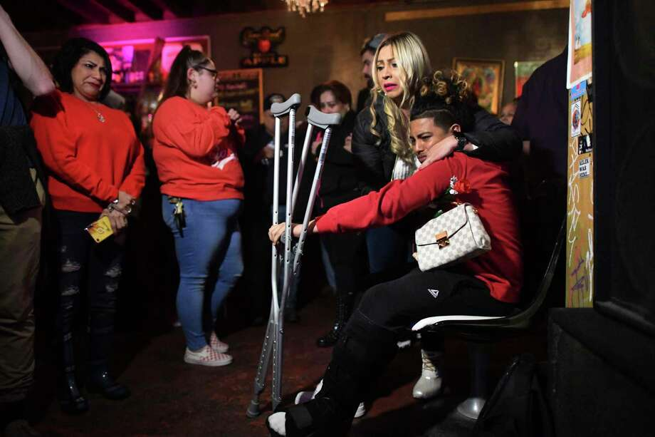 Ernesto Ortiz, who was hurt in the shooting that killed two people at the Ventura night club on the Museum Reach portion of the San Antonio River Walk on January 19, is comforted by Roxanne Ojeda during a memorial gathering at the club on Wednesday, Jan. 22, 2020. Robert Martinez and Alejandro Robles were allegedly killed by Kiernan Christopher Williams, who had been charged with capital murder in connection with the Jan. 19 shootings. Photo: Billy Calzada /Staff Photographer / ***MANDATORY CREDIT FOR PHOTOG AND SAN ANTONIO EXPRESS-NEWS /NO SALES/MAGS OUT/TV