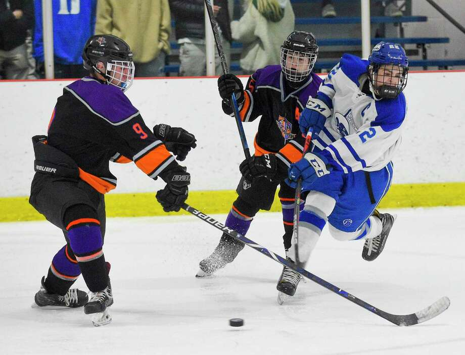 Darien's Bennett McDermott (22) slaps a shot past Stamford Westhill Co-op's Tyler Tuccinardi (9) towards the goal in the second period of an FCIAC boys hockey game at the Darien Ice House on Jan. 22, 2020 in Darien Connecticut. McDermmott scored three goals, including the game winning goal in over time for the Bluewaves 5-4 OT win. Photo: Matthew Brown / Hearst Connecticut Media / Stamford Advocate
