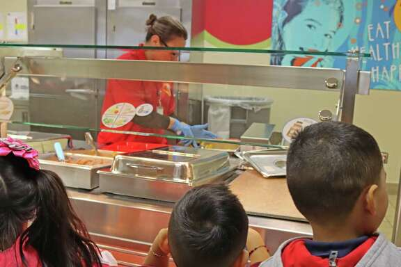 Students at Stafford MSD wait in line at the cafeteria for lunch.