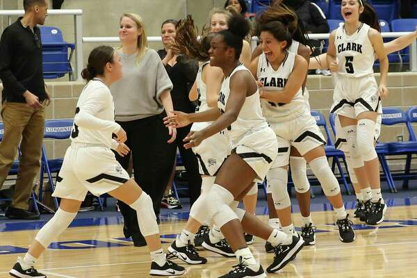 Clark players celebrate after defeating Brandeis in double overtime in girls basketball at Northside ISD Gym on Wednesday, Jan. 22, 2020. Clark defeated Brandeis, 53-51, in double overtime.