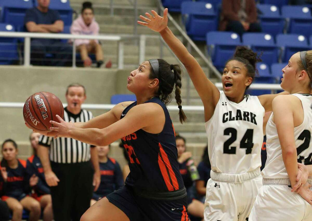 Brandeis' Arriana Villa (23) attempts a score against Clark's Aaliyah Roberson (24) during their girls basketball game at Northside ISD Gym on Wednesday, Jan. 22, 2020. Clark defeated Brandeis, 53-51, in double overtime.