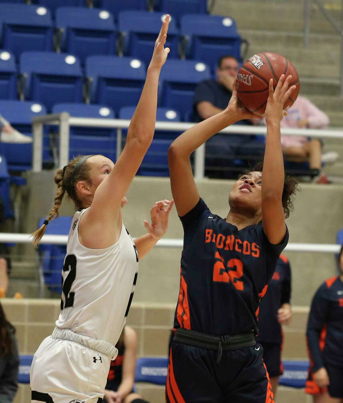 Brandeis' Alexis Parker (22) attempts a shot against Clark's Hailey Adams (left) during their girls basketball game at Northside ISD Gym on Wednesday, Jan. 22, 2020. Clark defeated Brandeis, 53-51, in double overtime.