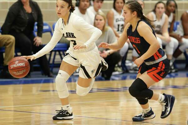 Clark's Sydney Solitaire (left) pushes the ball up court against Brandeis' Kaia Herrera (right) during their girls basketball game at Northside ISD Gym on Wednesday, Jan. 22, 2020. Clark defeated Brandeis, 53-51, in double overtime.
