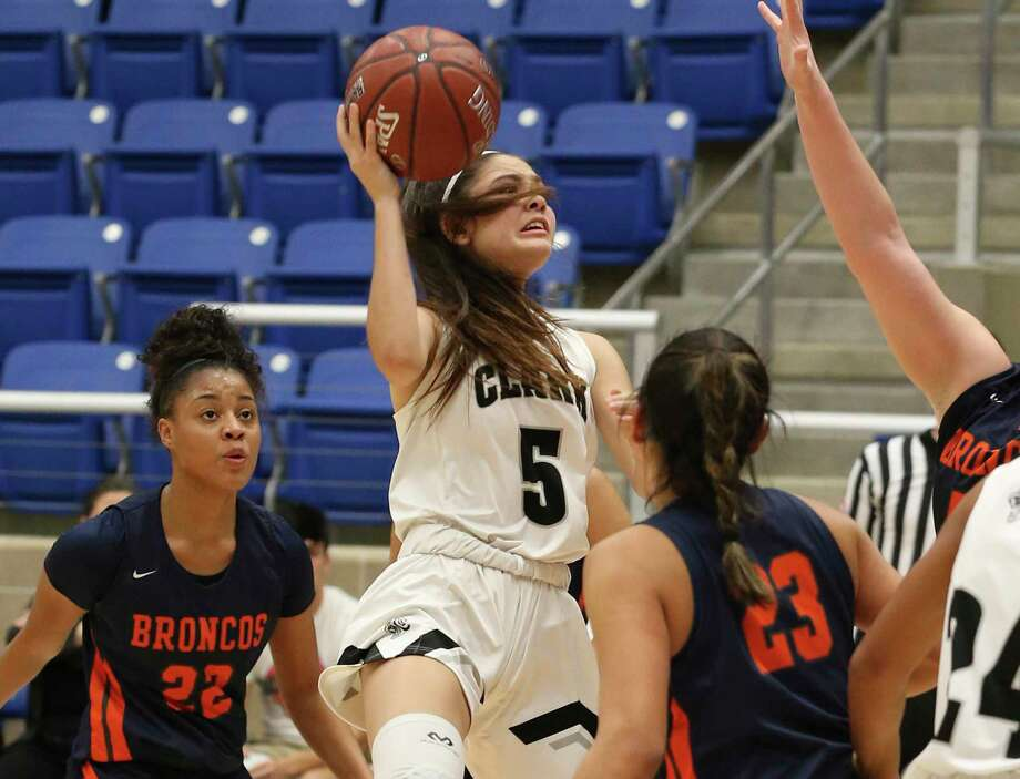 Clark's Ramsey Robledo (05) attempts a shot against Brandeis' Arriana Villa (23) and Alexis Parker (22) during their girls basketball game at Northside ISD Gym on Wednesday, Jan. 22, 2020. Clark defeated Brandeis, 53-51, in double overtime. Photo: Kin Man Hui, San Antonio Express-News / Staff Photographer / **MANDATORY CREDIT FOR PHOTOGRAPHER AND SAN ANTONIO EXPRESS-NEWS/NO SALES/MAGS OUT/ TV OUT