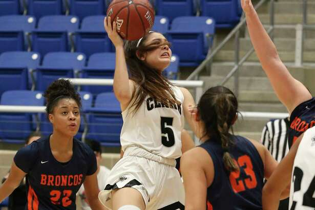 Clark's Ramsey Robledo (05) attempts a shot against Brandeis' Arriana Villa (23) and Alexis Parker (22) during their girls basketball game at Northside ISD Gym on Wednesday, Jan. 22, 2020. Clark defeated Brandeis, 53-51, in double overtime.