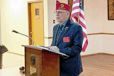 Richard Heigert, the national vice commander of the American Legion, addresses the Jacksonville post of the American Legion on Wednesday as part of a family caravan to encourage members to renew their membership.