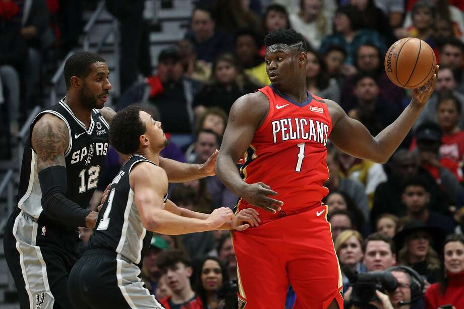 Zion Williamson (1) of the New Orleans Pelicans looks to pass the ball over Bryn Forbes (11) of the San Antonio Spurs at Smoothie King Center on January 22, 2020, in New Orleans, Louisiana. Photo: Chris Graythen, Getty Images
