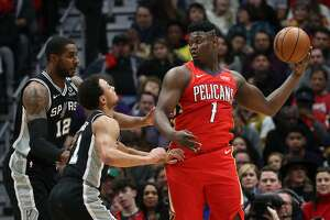 NEW ORLEANS, LOUISIANA - JANUARY 22: Zion Williamson #1 of the New Orleans Pelicans looks to pass the ball over Bryn Forbes #11 of the San Antonio Spurs at Smoothie King Center on January 22, 2020 in New Orleans, Louisiana. NOTE TO USER: User expressly acknowledges and agrees that, by downloading and/or using this photograph, user is consenting to the terms and conditions of the Getty Images License Agreement.   (Photo by Chris Graythen/Getty Images)