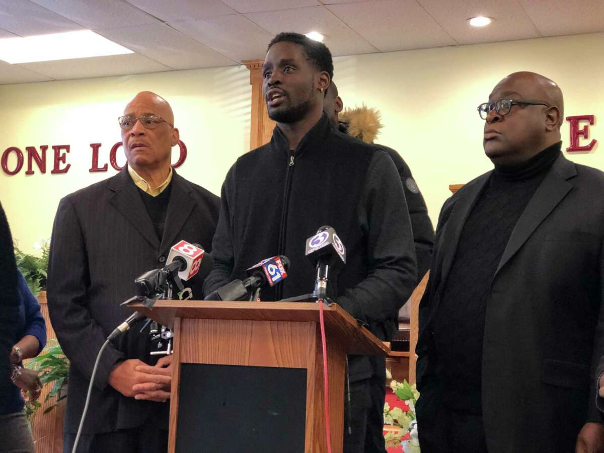 Family members and local clergy called for a federal investigation into the slaying of Mubarak Soulemane by state police Friday.