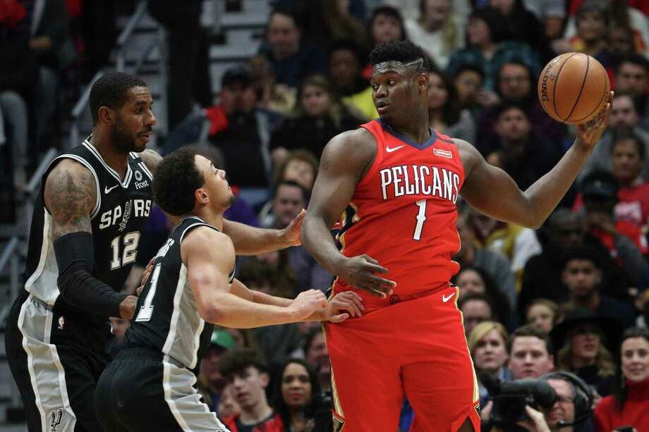 Zion Williamson looks to pass out of a double-team by LaMarcus Aldridge and Bryn Forbes. The No. 1 overall pick got off to a slow start in his much-hyped first official appearance for the Pelicans on Wednesday night, but he finished with 22 points in just 18 minutes. Photo: Chris Graythen /Getty Images / 2020 Getty Images