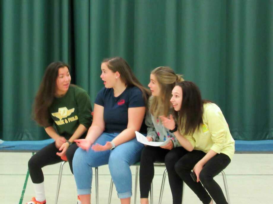 Dow High seniors Isabella Rhee, Maya Baker, Sydni Nikolai and Libby Stoecker rehearse on Monday, Jan. 20 for the school's annual talent show, RenFair. (Victoria Ritter/vritter@mdn.net)