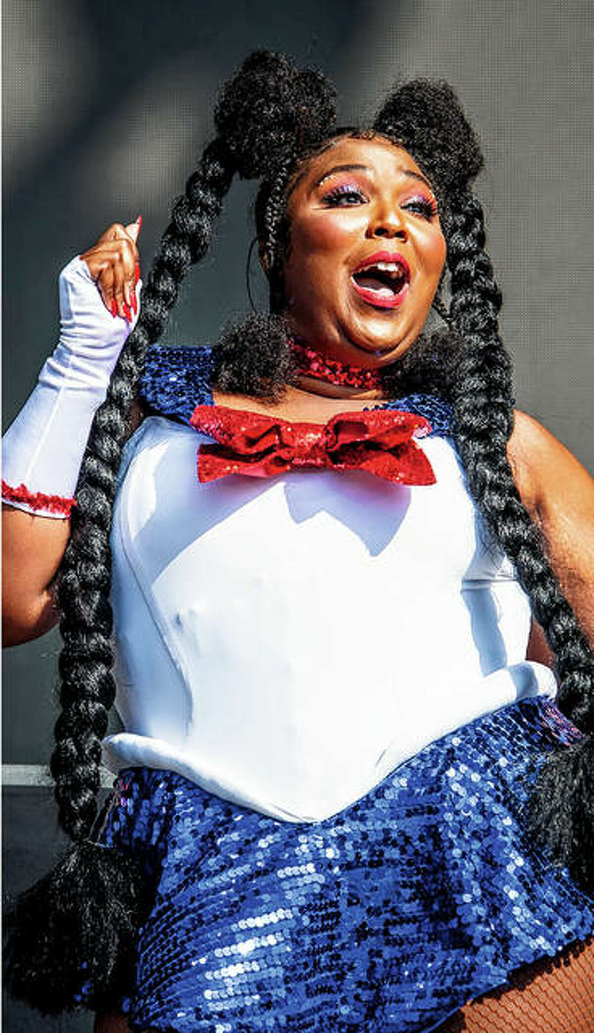 """Lizzo (above) performs in October 2018 at the Voodoo Music Experience in New Orleans. Lil Nas X (right) performs """"Old Town Road"""" on June 23 during the BET Awards in Los Angeles."""
