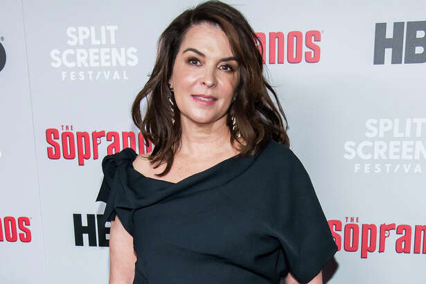 """FILE - In this Jan. 9, 2019, file photo, Annabella Sciorra attends HBO's """"The Sopranos"""" 20th anniversary at the SVA Theatre in New York. Sciorra is set to confront Harvey Weinstein at his New York City rape trial, more than a quarter-century after she says he pinned her to a bed and raped her. She is expected to testify Thursday, Jan. 23, 2020. (Photo by Charles Sykes/Invision/AP, File)"""