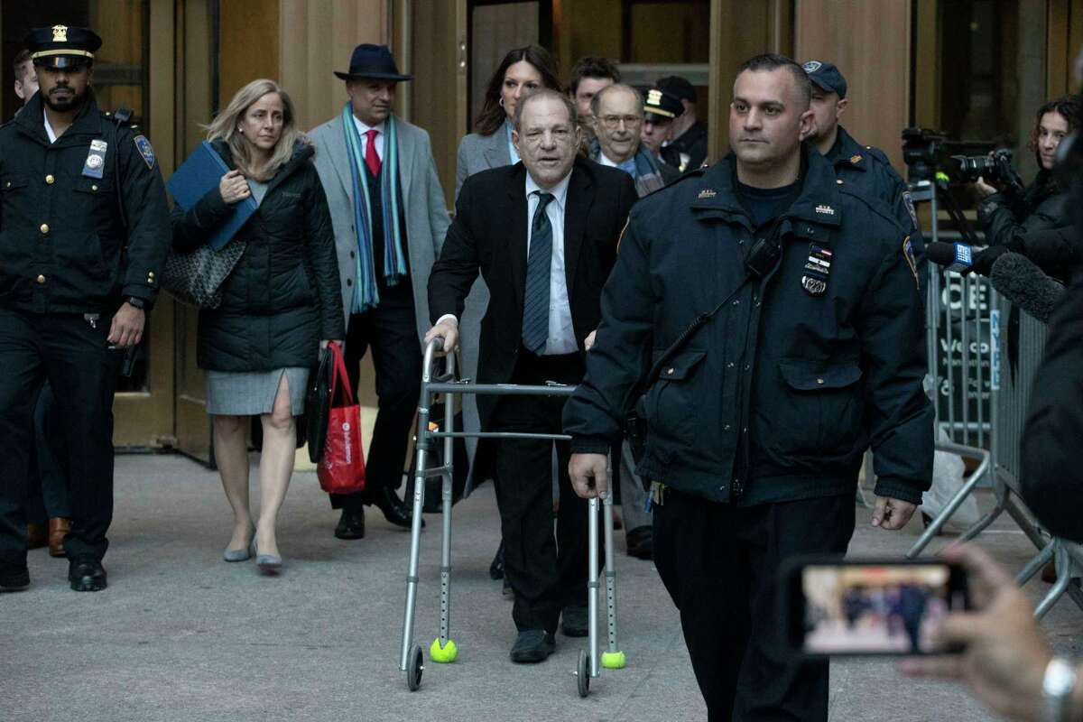 Harvey Weinstein, center, leaves a Manhattan courthouse following a day in his trial on rape and sexual assault charges, Wednesday, Jan. 22, 2020 in New York.