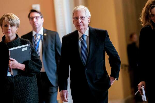Senate Majority Leader Mitch McConnell, R-Ky., walks back to the Senate floor after a break during the impeachment trial of President Trump on Wednesday.