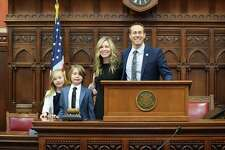 Brian Farnen with his wife Kimberly and their two children after the swearing-in ceremony Tuesday.