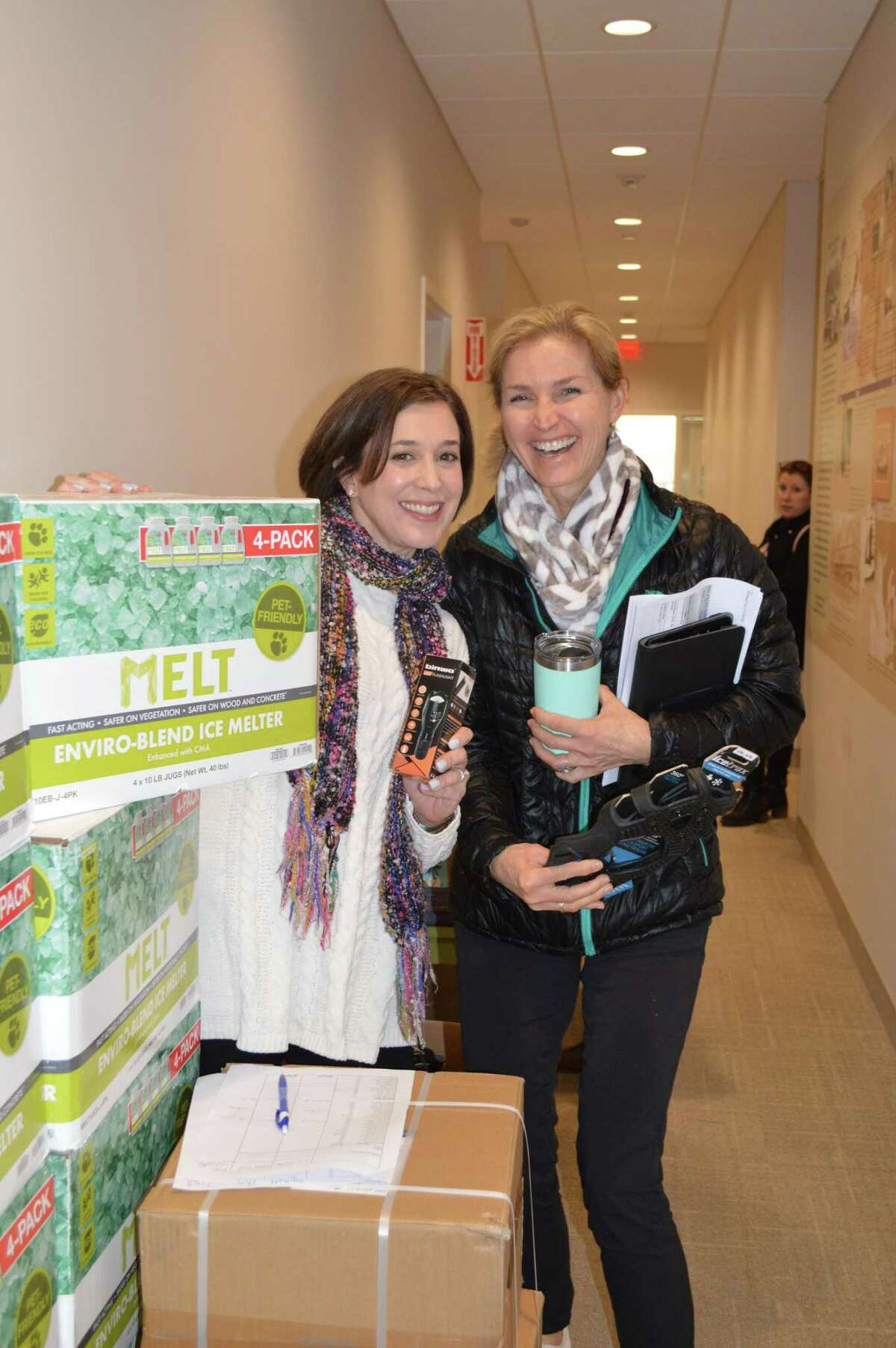 Physical therapists Kris Greco and Tricia Brody grab some ice melt for the road.
