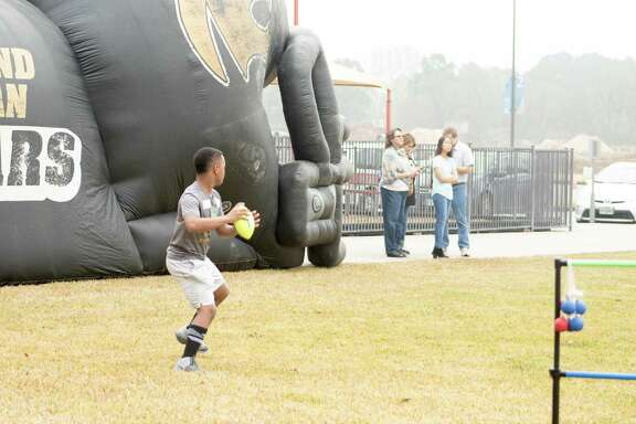 Kids from the community play a game of pickup football on the Faithbridge front lawn.