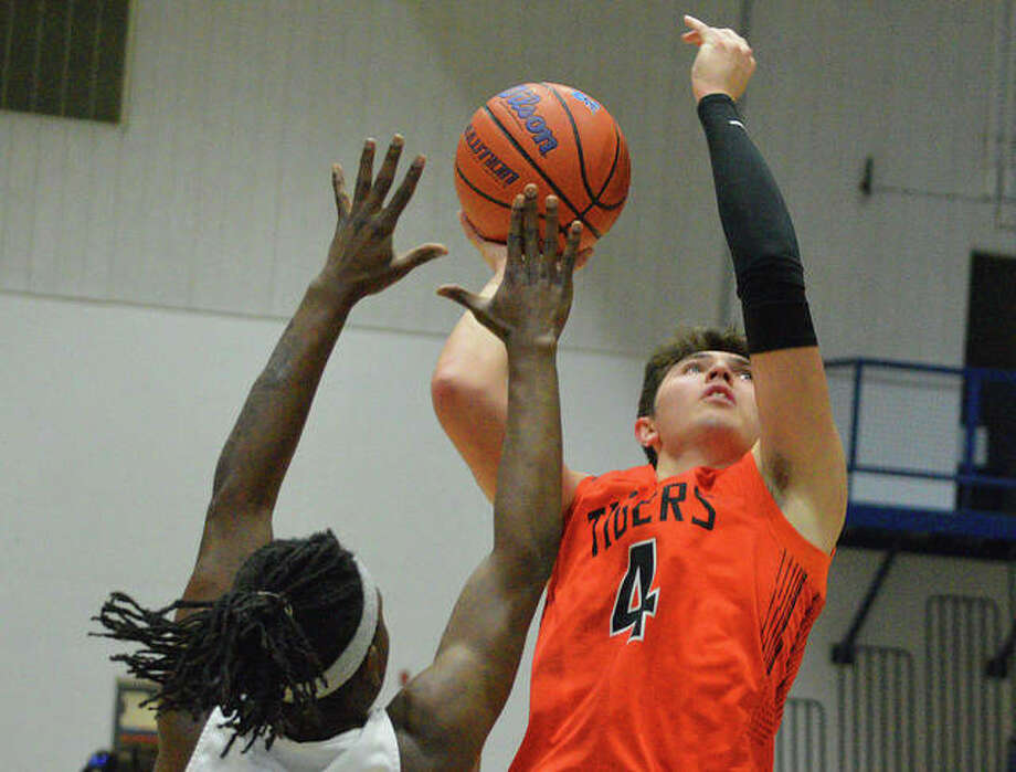 Edwardsville's Nic Hemken puts up a shot over a Cahokia defender during the Jersey Mid-Winter Classic on Wednesday. Photo: Scott Marion/The Intelligencer
