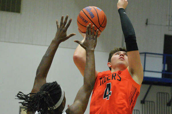 Edwardsville's Nic Hemken puts up a shot over a Cahokia defender during the Jersey Mid-Winter Classic on Wednesday.