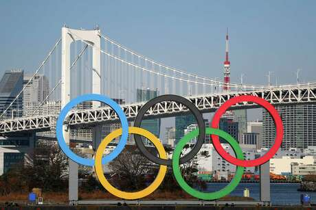 TOKYO, JAPAN - JANUARY 20: The Olympic rings are seen in front of Tokyo's iconic Rainbow Bridge and Tokyo Tower on January 20, 2020 in Tokyo, Japan.