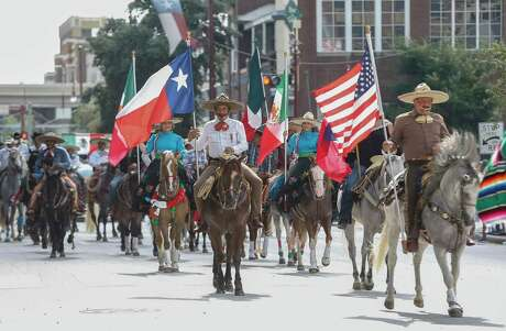 Vaqueros ride along the parade route during the 50th Annual Houston Fiestas Patrias Parade Saturday, Sept. 15, 2018, in Houston.