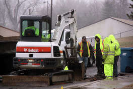 Edwardsville Public Works crews work to repair a water main break on Schiller Avenue on Thursday, just north of Tower Avenue. The 10-inch pipe broke early Thursday morning and affected streets over a wide area, including two schools.