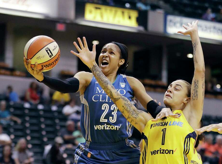 Minnesota Lynx's Maya Moore, left, shoots against Indiana Fever's Jazmon Gwathmey during the first half of a WNBA basketball game in Indianapolis on Aug. 30, 2017. Photo: Darron Cummings / Associated Press / Copyright 2017 The Associated Press. All rights reserved.