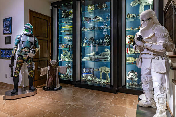 A mansion in the Hidden Hills neighborhood of Los Angeles is listed for $26.5 million. The home features six bedrooms, seven bedrooms and a 5,000-square-foot 'Star Wars' museum in the basement.