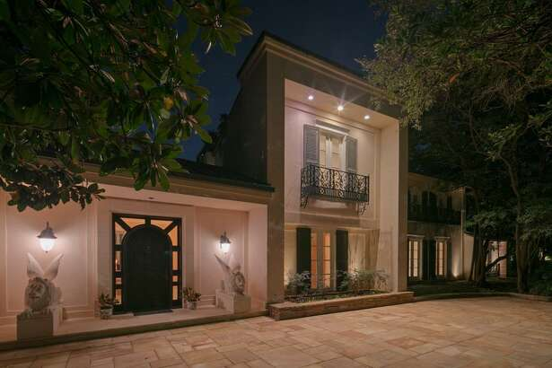 This River Oaks property features three swimming pools and a tennis court.