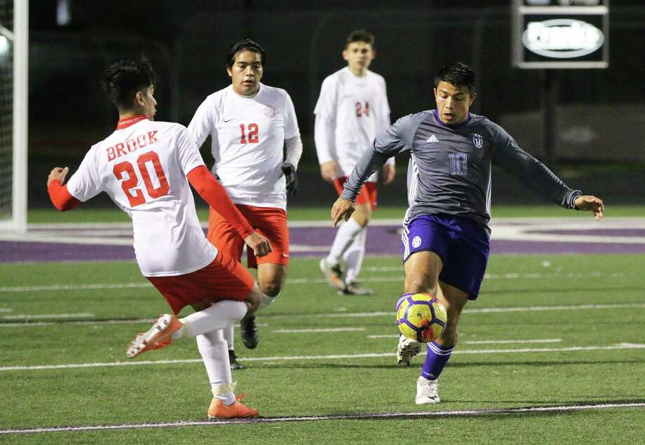 Junior forward David Perez kicks the ball down the field for his teammates as the Broncos continued to pressure the Wolverines all night. Photo: David Taylor / Staff Photo