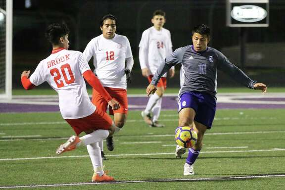 Junior forward David Perez kicks the ball down the field for his teammates as the Broncos continued to pressure the Wolverines all night.