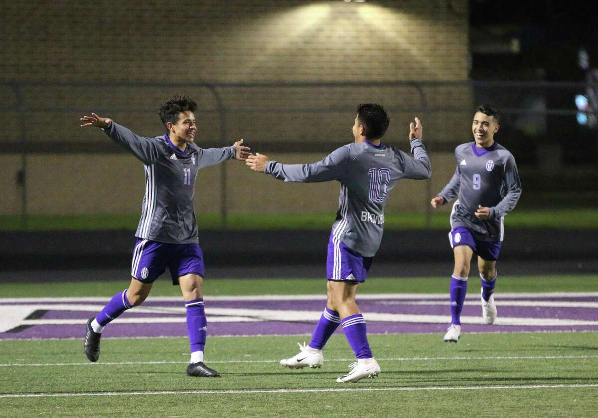 Forward Jorge Sifuentes and midfielder David Perez run over to celebrate with Bryan Martinez after Perez gave Martinez the assist on a goal in the second half of the non-district game against Clear Brook. The Broncos won the game, 3-0.