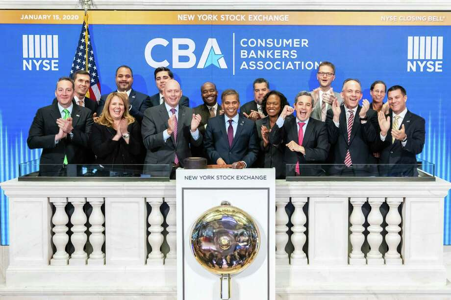 Wilton resident Nitin Mhatre, executive vice president, head of Community Banking at Webster Bank, center, rings the New York Stock Exchange's closing bell on Jan. 15, 2020. Photo: Courtney Crow / NYSE / Copyrighted