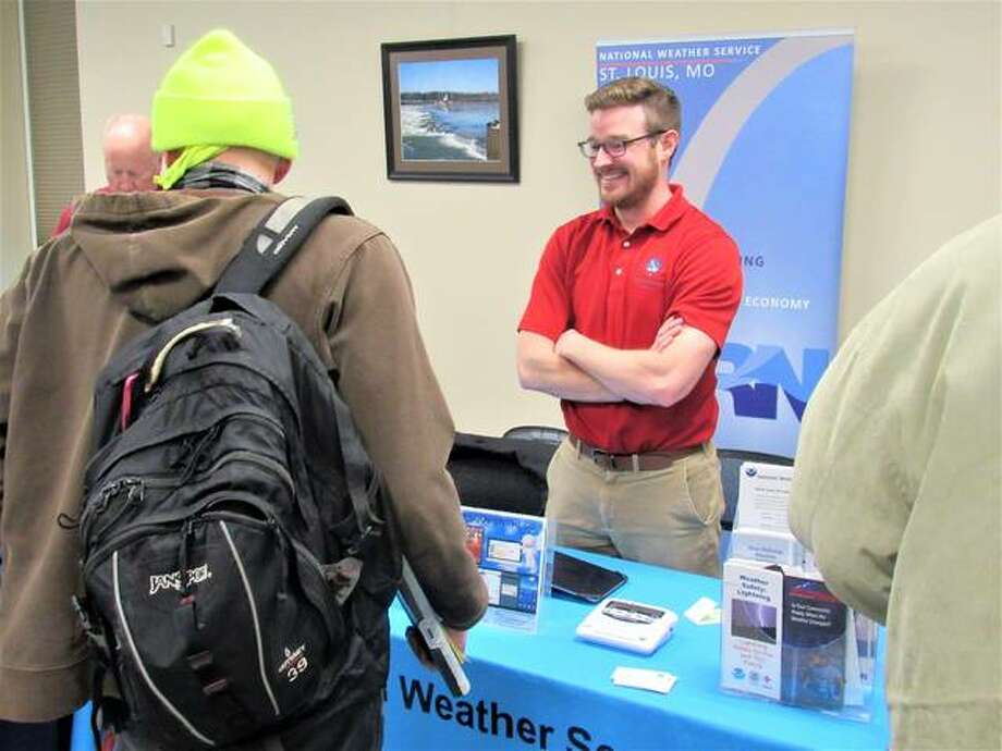 Kevin Deitsch of the National Weather Service in St. Louis talks with Wednesday guests at the FloodPrep tour that visited the National Great Rivers Museum in Alton.