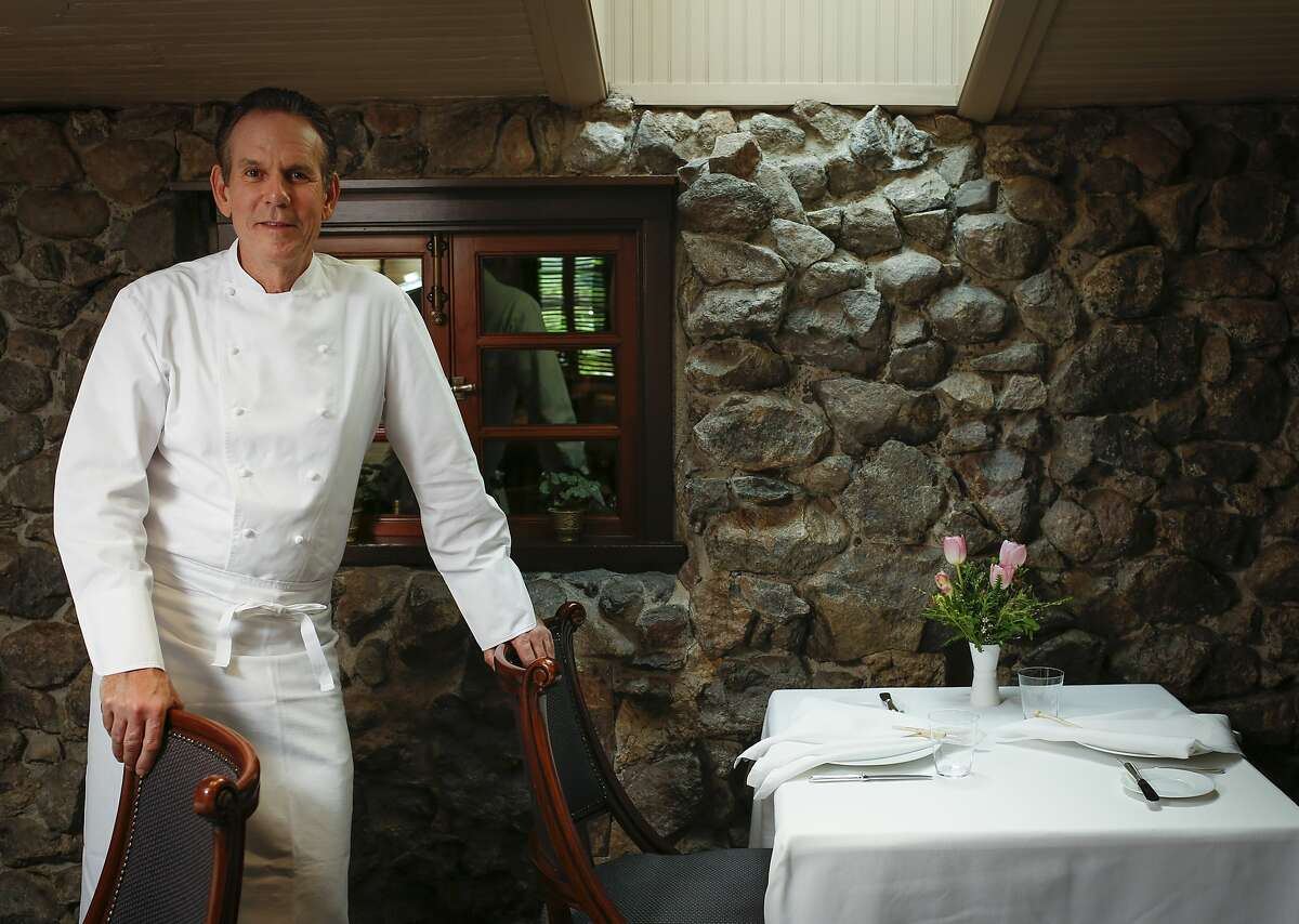 Thomas Keller stands in front of the original exterior wall of the French Laundry in Yountville. The chef has recently come under fire for praising a major Donald Trump donor.