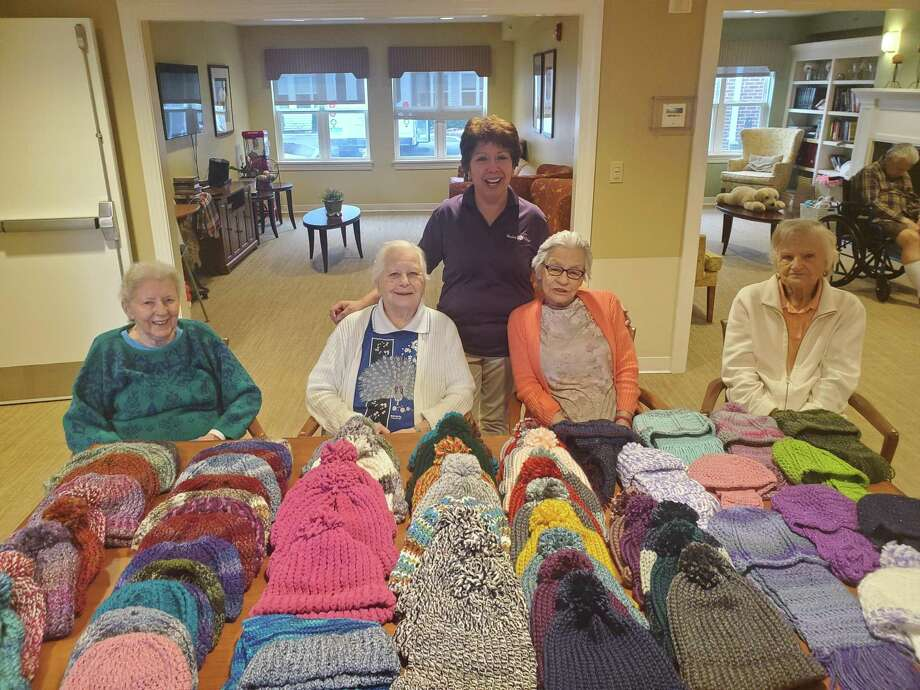 Helen Krystopowicz, Dorothy Guaglianone, Joanne Ruscoe, Luella Dwyer and Graciella Lopez were part of the knitting and crocheting group at Wesley Village who made the hats and scarves to donate. Photo: Contributed Photo / Connecticut Post