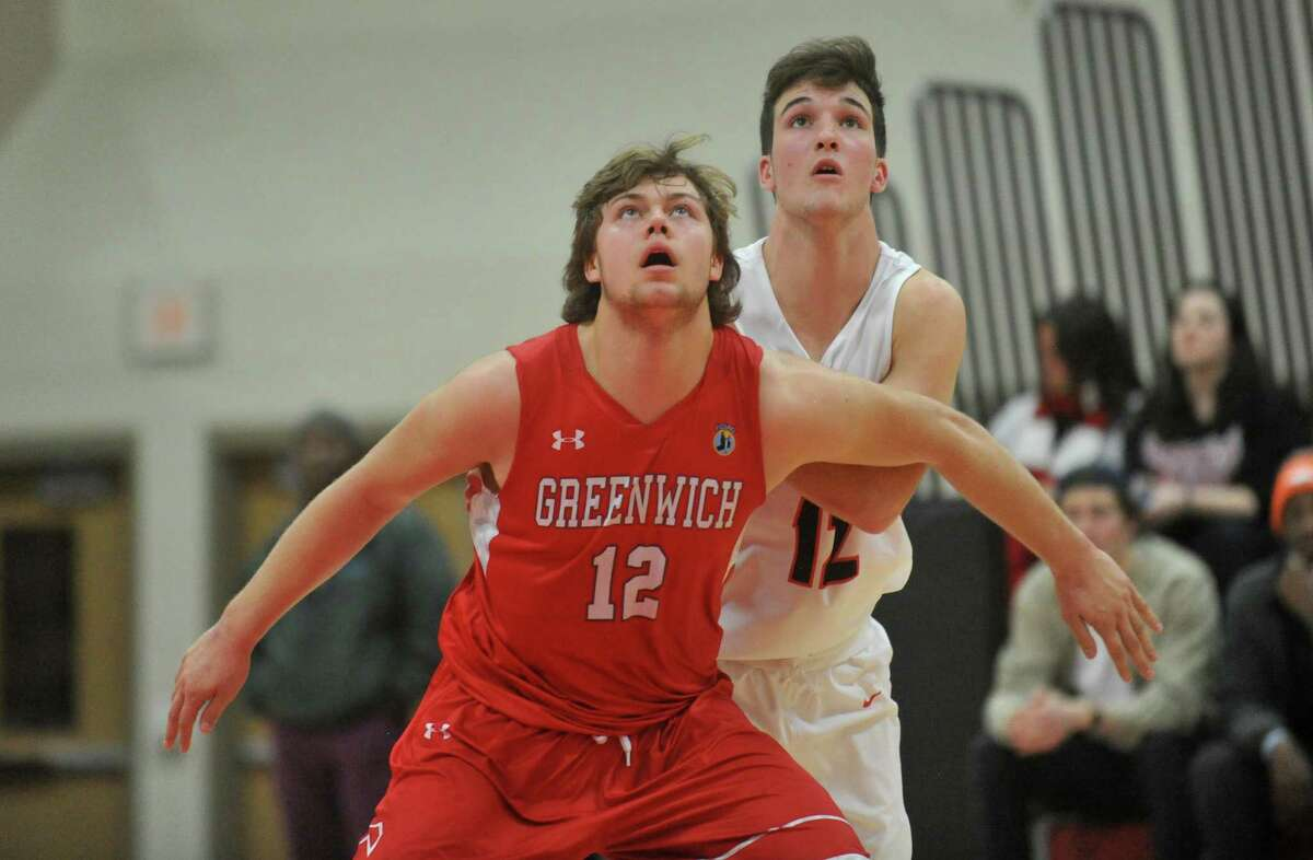 FCIAC basketball game action between the Greenwich Cardinals and the New Canaan Rams played on Friday December 21, 2018 at New Canaan High School in New Canaan, Connecticut.