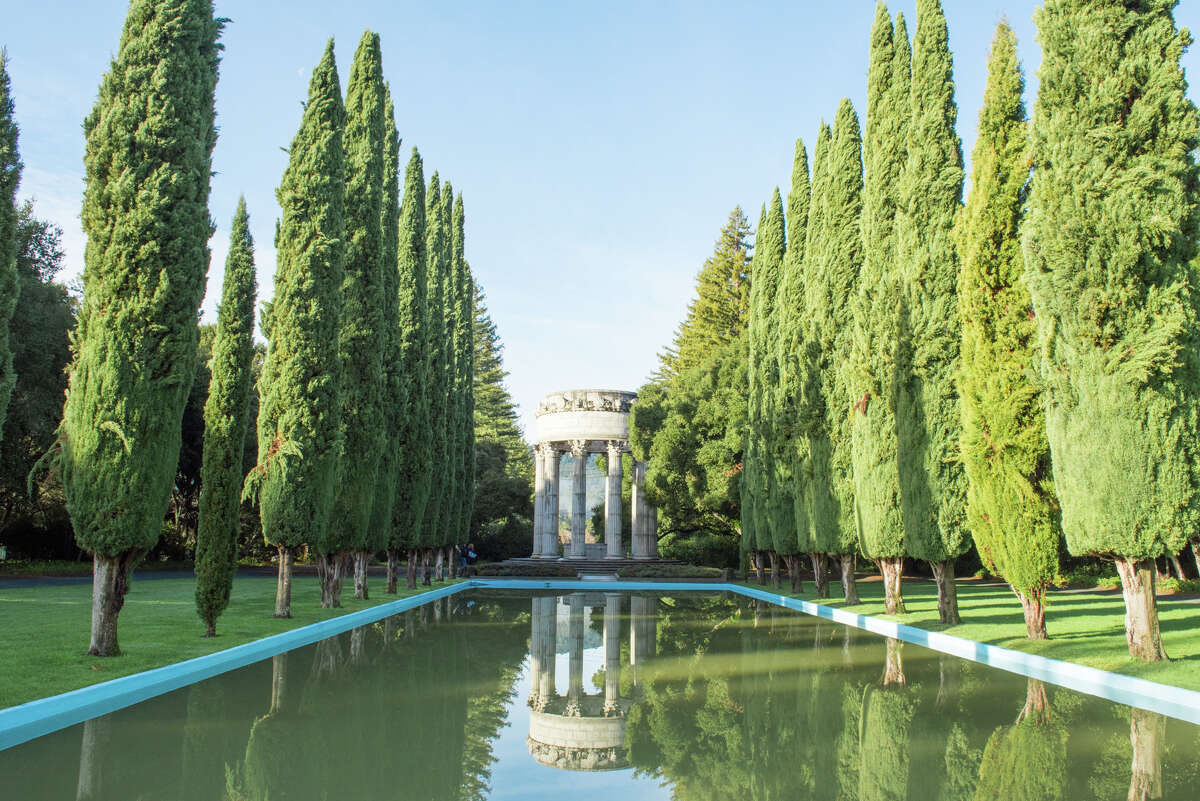 Cypress trees line the reflecting pool of the Pulgas Water Temple off Canada Road near Woodside, Calif. The temple celebrates the arrival of Hetch Hetchy water to San Francisco in 1934, a project that took 20 years to complete.