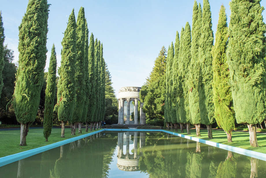 Cypress trees line the reflecting pool of the Pulgas Water Temple off Canada Road near Woodside, Calif. The temple celebrates the arrival of Hetch Hetchy water to San Francisco in 1934, a project that took 20 years to complete. Photo: Blair Heagerty / SFGate