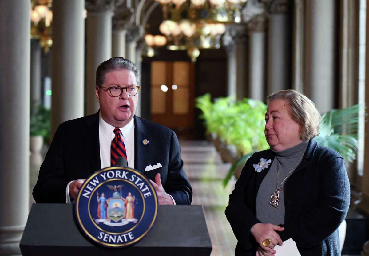 New York State Senators Pete Harckham, left, and Liz Krueger, right, hold a press conference on marijuana legislation on Thursday, Jan. 23, 2020, to at the Capitol in Albany, N.Y. Sen. Harckham, who opposed legalization last year, announced support for Krueger's cannabis bill. (Will Waldron/Times Union)