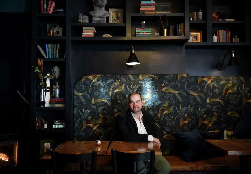 Interior designer Brendan Flanigan sits in a lounge area he created at The Bishop on Thursday, Jan. 9, 2020, in Albany, N.Y. (Will Waldron/Times Union)