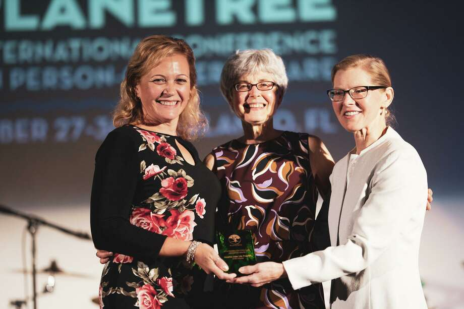 Planetree Services Supervisor at Griffin Health Laura Howell and Director Planetree Programs and Services Diane Betkoski receive The Person-Centered Care Innovation Award from Planetree International President Dr. Susan Frampton at the 2019 Planetree International Conference on Person-Centered Care. Photo: Contributed Photo
