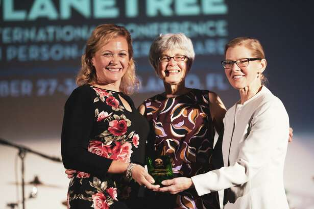 Planetree Services Supervisor at Griffin Health Laura Howell and Director Planetree Programs and Services Diane Betkoski receive The Person-Centered Care Innovation Award from Planetree International President Dr. Susan Frampton at the 2019 Planetree International Conference on Person-Centered Care.