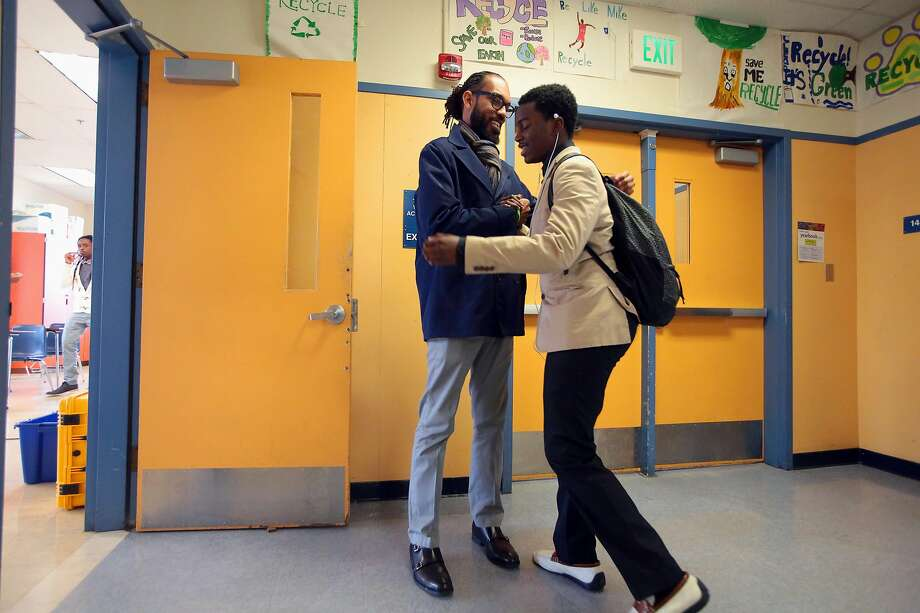 Lamar Hancock greets a student before a 2016 Manhood Development class at Oakland Technical High School. Men have been reluctant to take jobs that women traditionally held. Photo: Jim Wilson / New York Times 2016