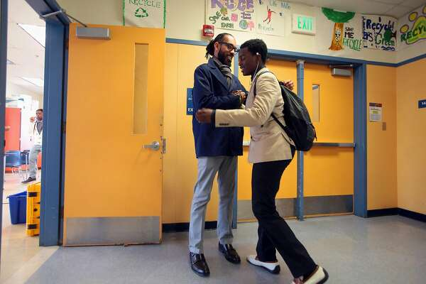FILE -- Lamar Hancock greets one of his students before his Manhood Development class at Oakland Technical High School in Oakland, Calif., Jan. 8, 2016. Jobs traditionally viewed as female still don't pay well, and still don't appeal to men. (Jim Wilson/The New York Times)