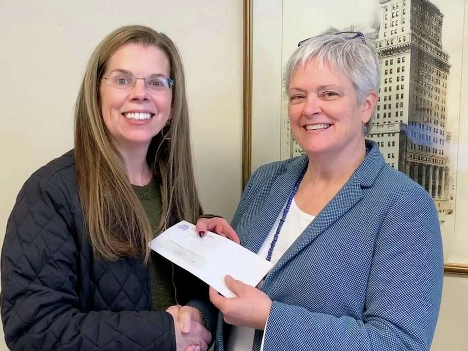 """Debra Franceschini-Gatje, commissioner on the Ridgefield Commission on Aging, recently presented Grace Weber, Founders Hall executive director, with a donation of $1,000. According to Weber, """"the generous support of the Commission on Aging makes Founders Hall programs accessible for all Ridgefield members."""" The Commission on Aging identifies the needs of senior citizens living in Ridgefield and coordinates services that further their well-being. Founders Hall is a donor-supported education and recreation center for individuals age 60 and older. Ridgefielders 60 and older, and their spouse, may join Founders Hall at anytime. Photo: Contributed Photo"""