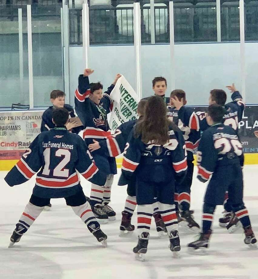 Gladwin Gladiators players celebrate their International Silver Stick championship in Pelham, Ontario, on Jan. 12. (Photo provided)